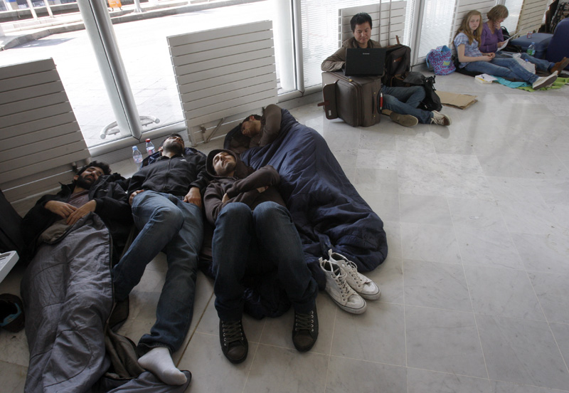 Stranded passengers camp out today at Roissy Charles de Gaulle Airport.