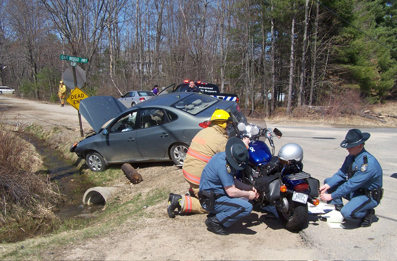 Police and rescue personnel on the scene of the collision on Carl Broggi Highway.