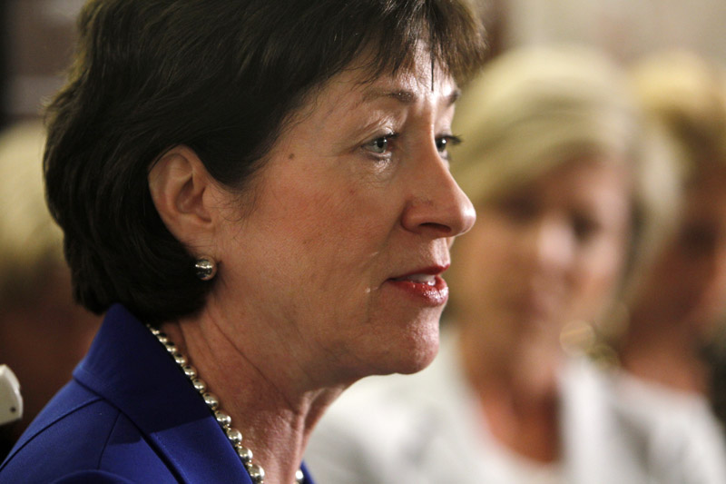 Sen. Susan Collins, R-Maine, speaks to reporters Monday after a private meeting with Treasury Secretary Timothy Geithner regarding financial reform at her office on Capitol Hill.