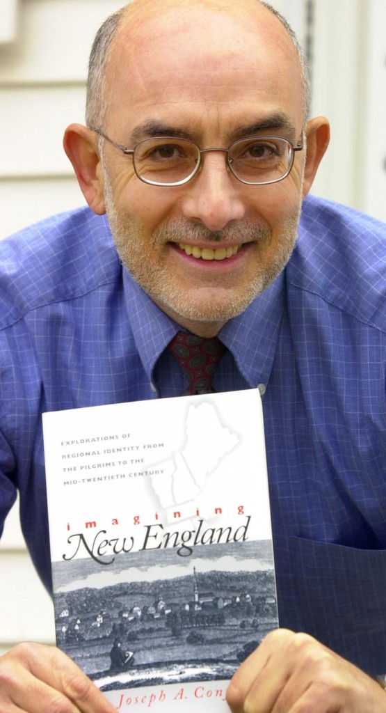 """University of Southern Maine history professor Joseph Conforti holds up his book """"Imagining New England: Explorations from the Pilgrims to the Mid-Twentieth Century"""" in 2001."""