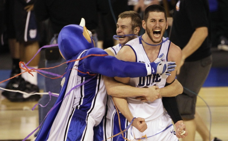 Duke players Brian Zoubek, right, Jon Scheyer, center, and the team mascot celebrate after Duke's 61-59 win over Butler in the men's NCAA Final Four college basketball championship game Monday in Indianapolis.