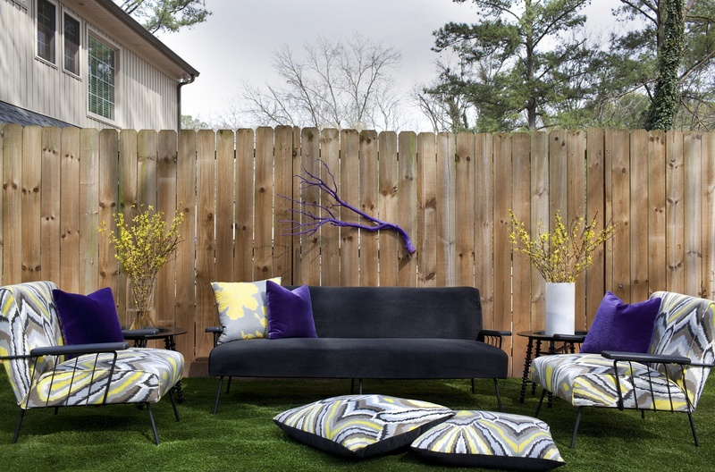 To create the budget-friendly outdoor living room above, designer Brian Patrick Flynn recovered patio furniture found at a flea market with indoor/outdoor fabrics.