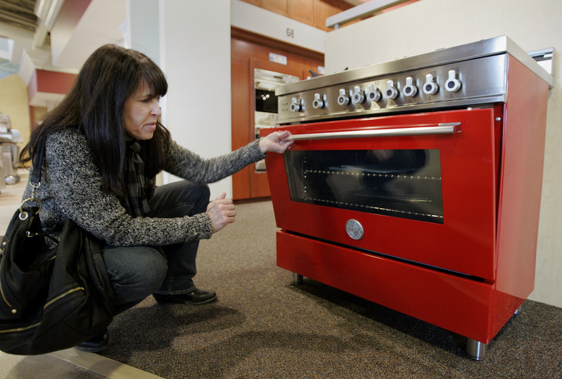 Brenda Knehans checks out a six-burner, 36-inch Bertazzoni range. The commercial-style home appliance retails for $4,699, though a more standard size from the line can be found for around $2,000. 10000000 krtfeatures features krtlifestyle lifestyle krtnational national leisure LIF krtedonly mct 10009000 FEA krthome home house housing LEI 2010 krt2010 kitchen appliance