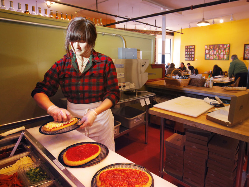 Kate Skinner makes pizzas at Pie in the Sky Pizza, upstairs at the Public Market House on Monument Square in Portland.