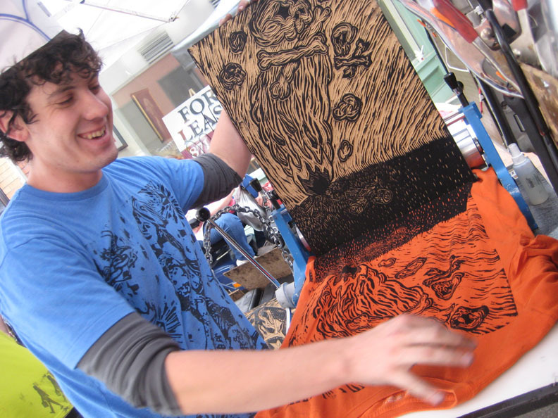 Drive By Press printmaker Greg Nanney creates one-of-a-kind shirts in front of the Maine College of Art.