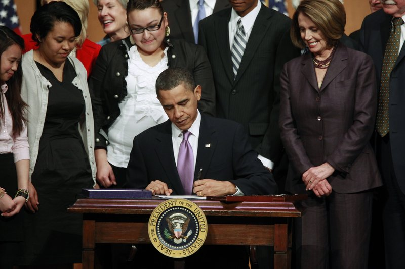 President Obama signs the health care bill into law. Readers say too much criticism has accompanied its process.