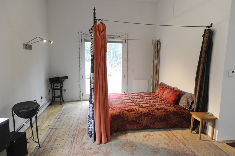 The bedroom, at the far end of the approximately 60-foot-long first floor