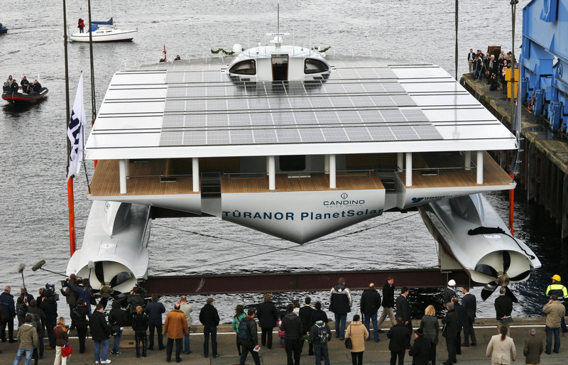"The solar-powered yacht ""Planetsolar"" yacht is launched at Kiel, northern Germany, on Wednesday. Six years in the building, the catamaran-style vessel now will undergo testing and prepping for a 140-day world tour starting in 2011."