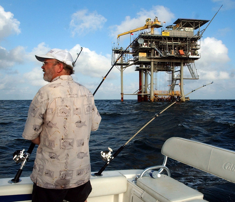A fisherman trolls the Gulf of Mexico near a natural gas well off the Alabama coast near Gulf Shores, Ala. In announcing his new offshore drilling policy Wednesday, President Obama said he wants to give the petroleum industry access to the southern Atlantic coastline, the eastern Gulf of Mexico and more of Alaska's coast.