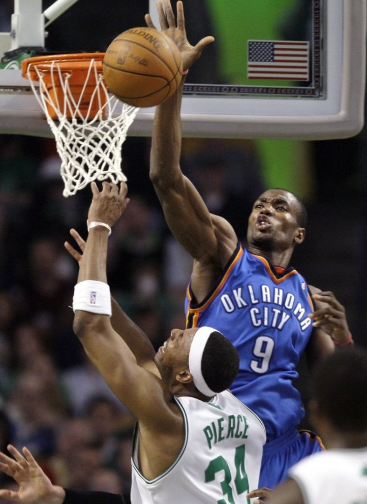 Serge Ibaka of the Oklahoma City Thunder swats away a shot by Paul Pierce of the Boston Celtics during the Thunder's 109-104 victory.