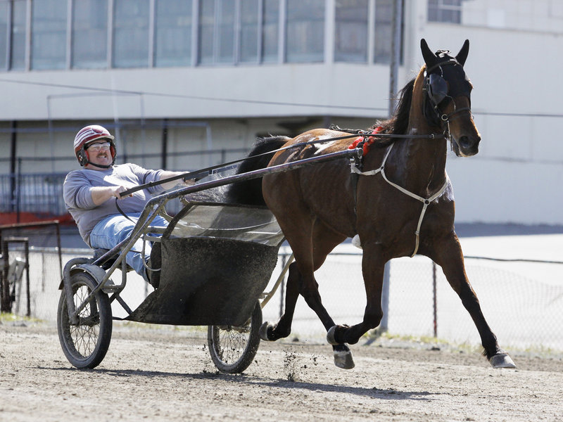 Richard Robertson Jr. of Scarborough jogs with Dua Don Thursday at Scarborough Downs. The track will be celebrating 60 years of harness racing this season.