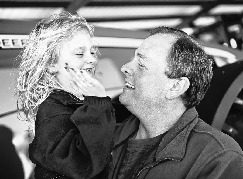 Stephen Fincher, a congressional candidate in western Tennessee, laughs with his daughter Sarah, 6, at the family farm in Frog Jump, Tenn. National Republicans are giddy about his strengths, but some tea party activists see his acceptance of farm subsidies as a negative.