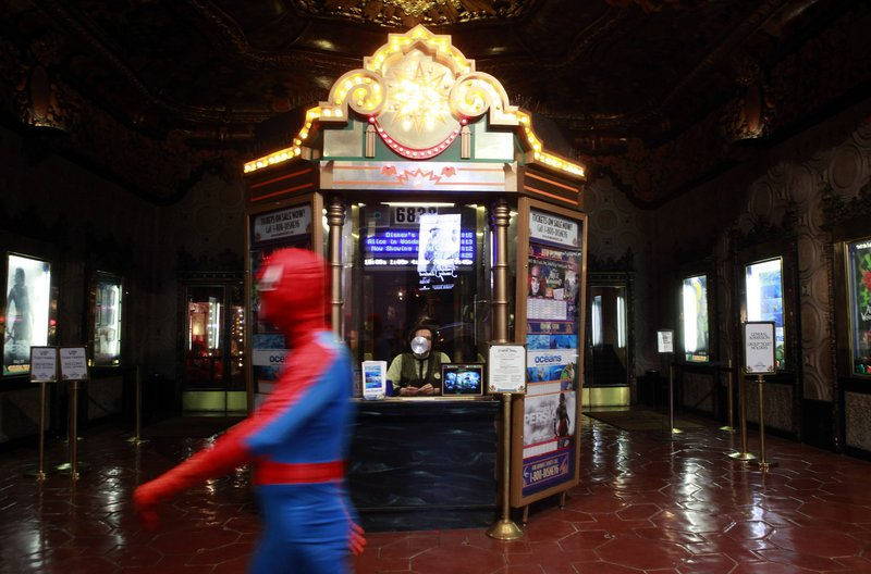 A person dressed as Spider-Man walks past the El Capitan Theatre in Los Angeles. The U.S. Commodity Futures Trading Commission is expected to rule this month on proposals to let speculators bet on a movie's expected box office receipts.