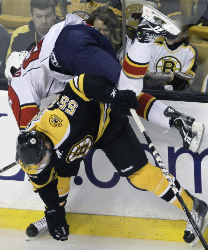 Bruins defenseman Johnny Boychuk upends Florida's Victor Oreskovich during the Panthers' 1-0 win Thursday night in Boston.