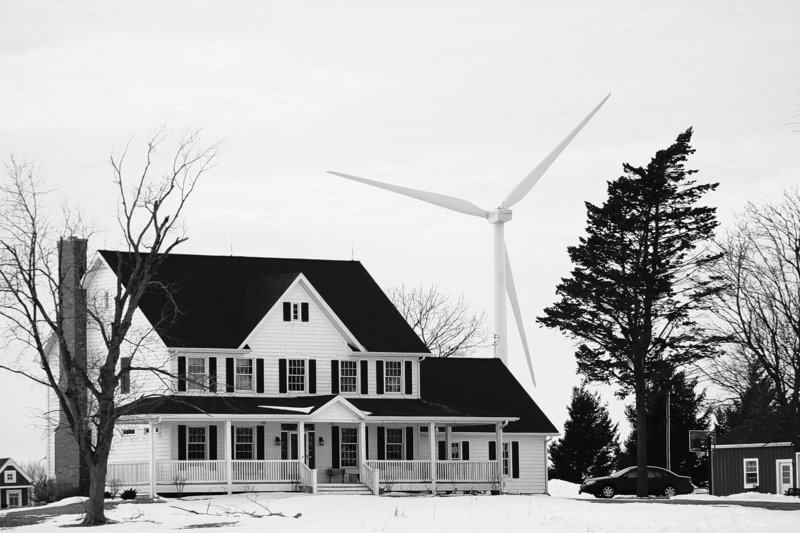 Wind turbines are only required to be at least 1,400 feet from the foundation of nearby homes such as this one in Shabbona, Ill.