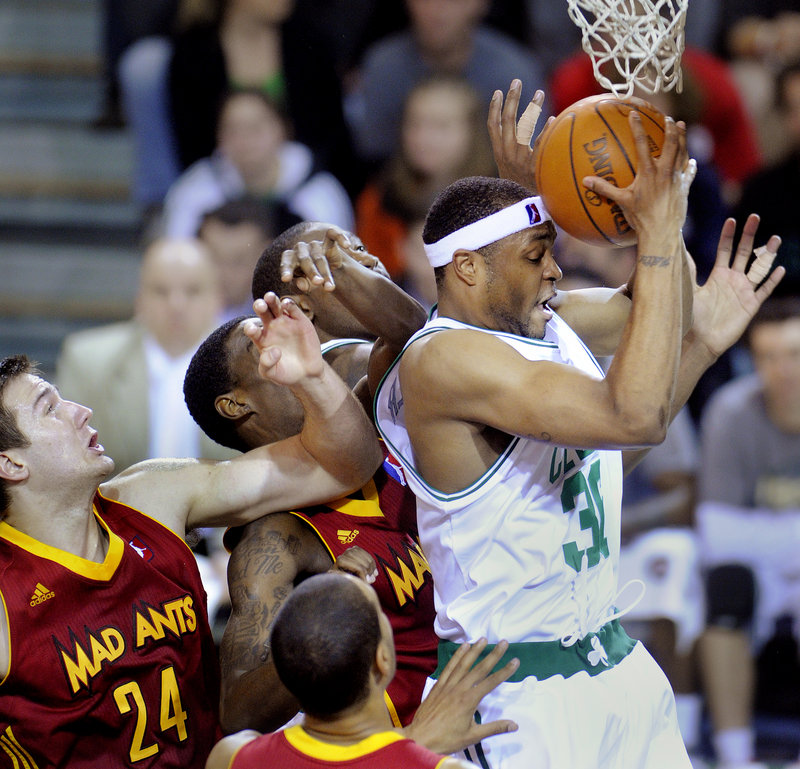 Maurice Ager of the Maine Red Claws pulls down an offensive rebound in traffic Friday night before scoring on the put-back. It wasn't enough to prevent the Red Claws from suffering a 105-92 loss to the Fort Wayne Mad Ants.