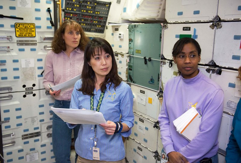 NASA astronauts, from left, Dorothy Metcalf-Lindenburger, Naoko Yamazaki and Stephanie Wilson train at the Space Vehicle Mock-up Facility at NASA's Johnson Space Center in Houston. A fourth woman, Caldwell Dyson, is already aloft.