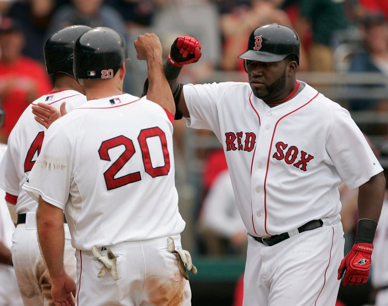 David Ortiz, right, had a horrible first two months last season, then reverted to form over the final four months. How Ortiz does on an offense that has the possibility of stumbling may determine just how far the Red Sox are able to go this season.