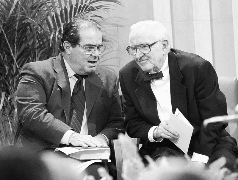 Supreme Court Justice John Paul Stevens, right, chats with fellow Justice Antonin Scalia in 2005. Stevens will likely be the next justice to retire, possibly as soon as this year.