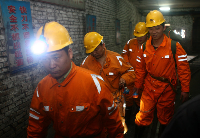 A rescue team enters Wangjialing coal mine to search for survivors in Xiangning, China, on Saturday.