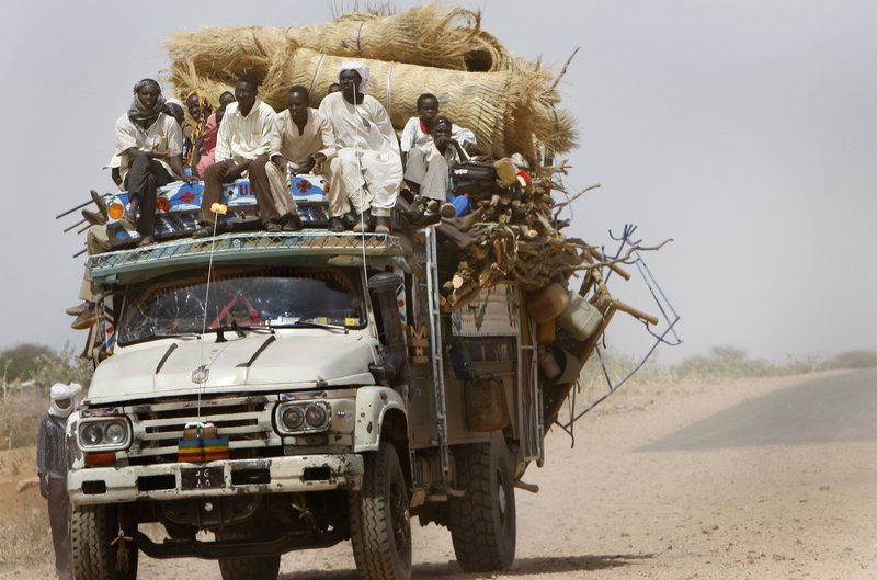 A truck loaded with new refugees enters Zamzam refugee camp, outside the Darfur town of El Fasher, in Sudan last month. Disarray in Sudan''s elections could end up fueling violence in Darfur and the south.