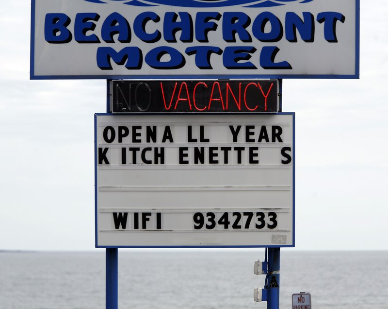 A vacancy sign is displayed at a motel in Old Orchard Beach. Water consumption is down partly because manufacturers have closed or are cutting back, tourism has fallen and the real estate market is in the doldrums.