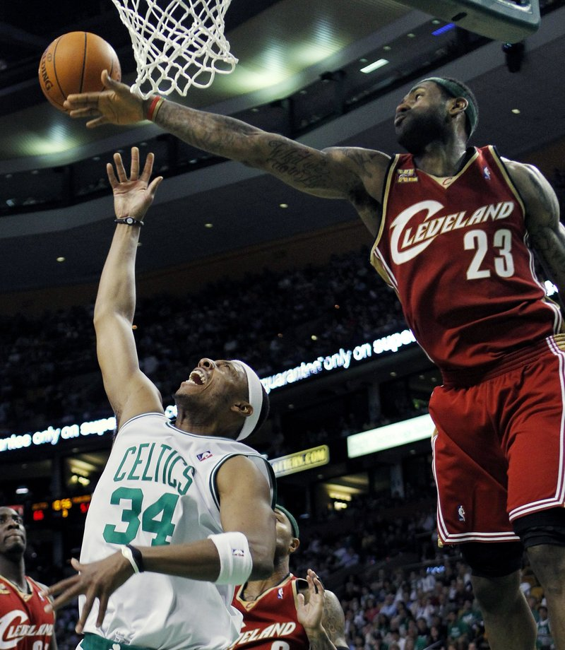 Paul Pierce, left, of the Celtics draws a foul by Cleveland's LeBron James during Sunday's game at Boston. Pierce had 16 points in the Celtics' 117-113 victory.