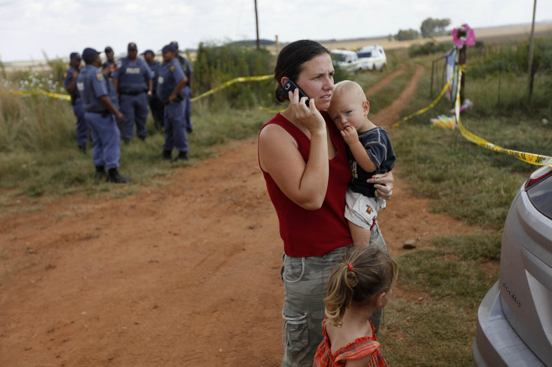 Followers of Afrikaner Weerstandsbeweging leader Eugene Terreblanche gather outside Ventersdorp, South Africa. Terreblanche was killed at his nearby farm Saturday, police said.