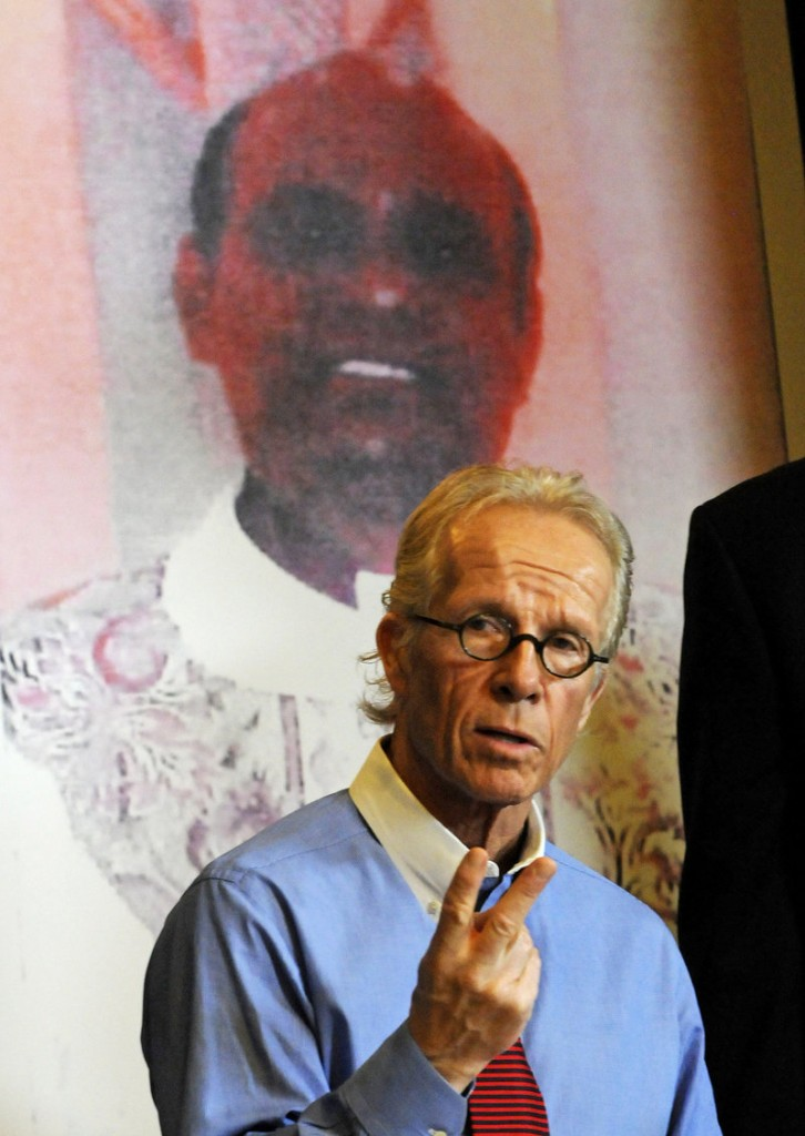 Jeff Anderson, attorney for a girl the Rev. Joseph Palanivel Jeyapaul is accused of sexually assaulting when she was 14, holds a news conference Monday in St. Paul, Minn., in front of a photo of the priest.
