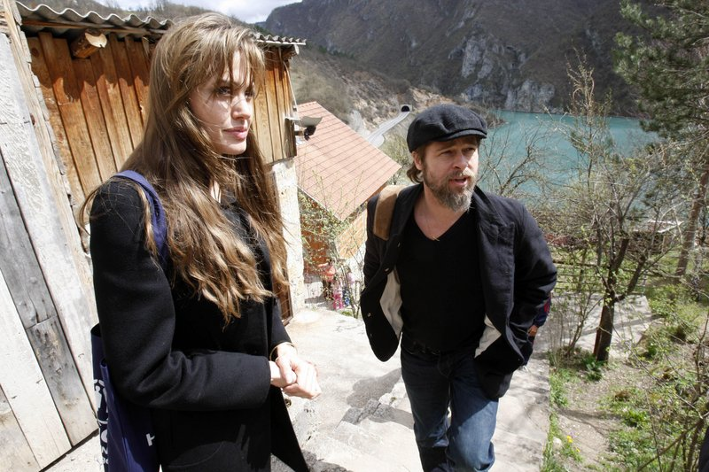 Angelina Jolie and Brad Pitt visit the Bosnian village of Medjedja on Monday. The movie stars hope to improve the plight of 117,000 refugees who are still unable to return to their homes, some 15 years after the end of the Bosnian war.