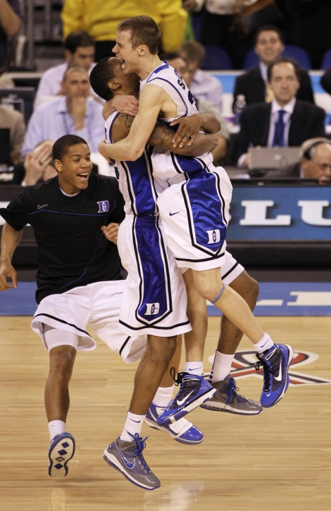 It's the end of a hard-fought championship game, and Jon Scheyer, right, and Lance Thomas begin Duke's celebration of its first national title since 2001 after a 61-59 victory Monday night over Butler.