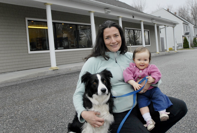 Owner Kristie Green poses outside the new location of Maple's Organics in South Portland, along with her 1-year-old daughter, Violet Milliken, and her border collie, Maple, for whom the business was named.