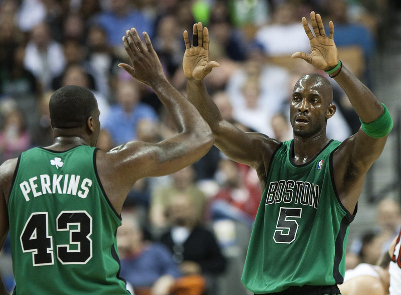 Kendrick Perkins, left, and Kevin Garnett of the Boston Celtics are all buddy-buddy Wednesday night, and why not? The Celtics beat the Toronto Raptors 115-104 and if you're counting, that's two straight years of sweeping the Raptors.