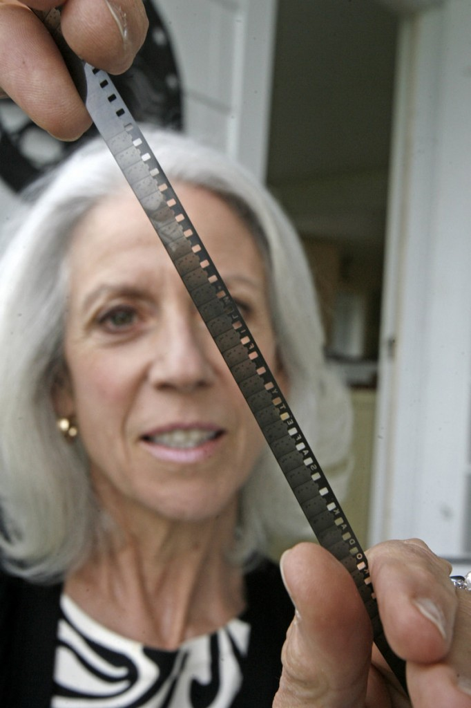 Susan Cooke Kittredge is overseeing the viewing of the 11-minute 8mm home movie featuring Charlie Chaplin made by her father, Alistair Cooke, in the 1933.
