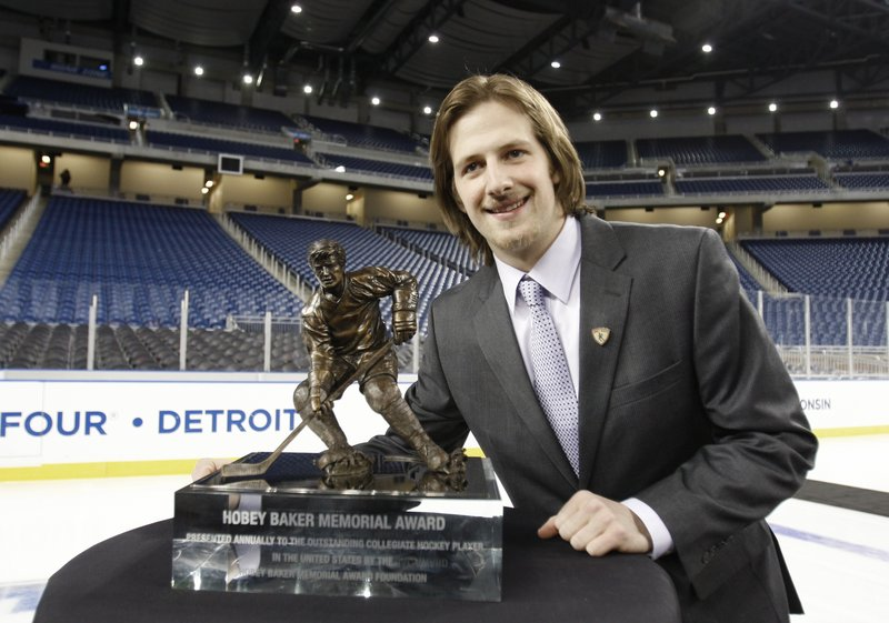 Blake Geoffrion poses with the Hobey Baker trophy after being named college hockey's best player.