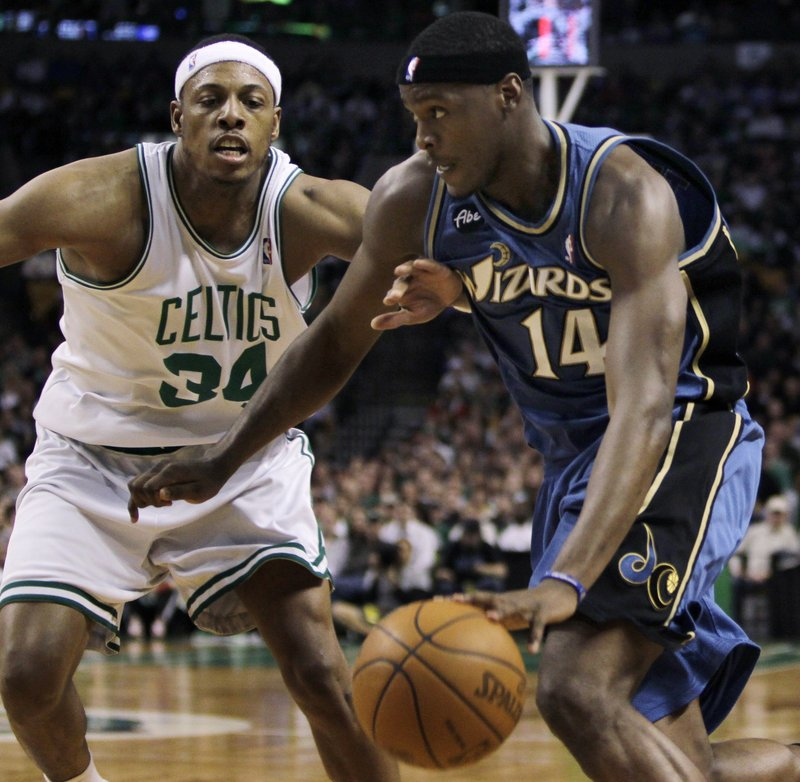 Al Thornton, right, of the Washington Wizards drives past Paul Pierce of the Celtics, who stunningly trailed 47-19 late in the first half before suffering a 106-96 setback.