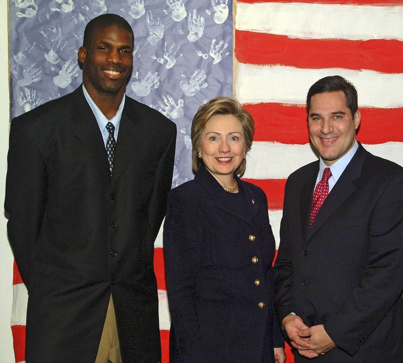 Kwame James, left, is shown in an undated photo with his lawyer Michael Wildes and then-Sen. Hillary Rodham Clinton, D-N.Y., who took an interest in his quest to become a U.S. citizen. The process took 10 years.