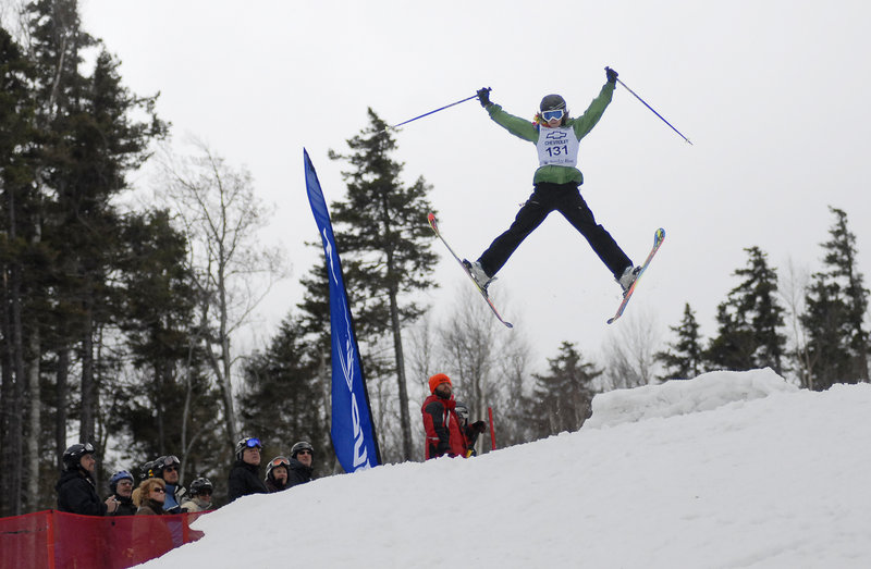 Rac Goodermote takes a jump in the Bust ''n'' Burn amateur mogul competition during the Parrot Head Festival at Sunday River on Saturday.