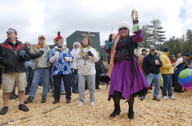 Sandy Clendenny of Providence, R.I., dances as the Ba Ha Brothers band entertains the crowd on Saturday.