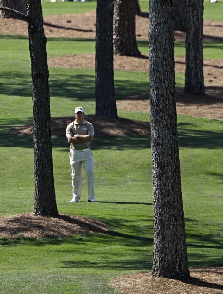 Lee Westwood surveys his options after a wayward drive on the seventh hole Saturday at the Masters. Westwood shot a 4-under 68 and was in the lead at 12 under.