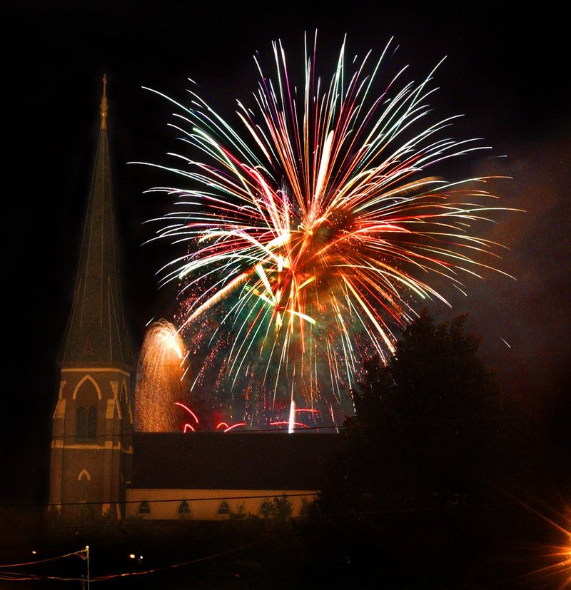 Fireworks blossom behind the Cathedral of the Immaculate Conception in Portland in 2002. Local business leaders have come forward to make sure the show goes on this year, after the display was cut from the city's proposed budget.