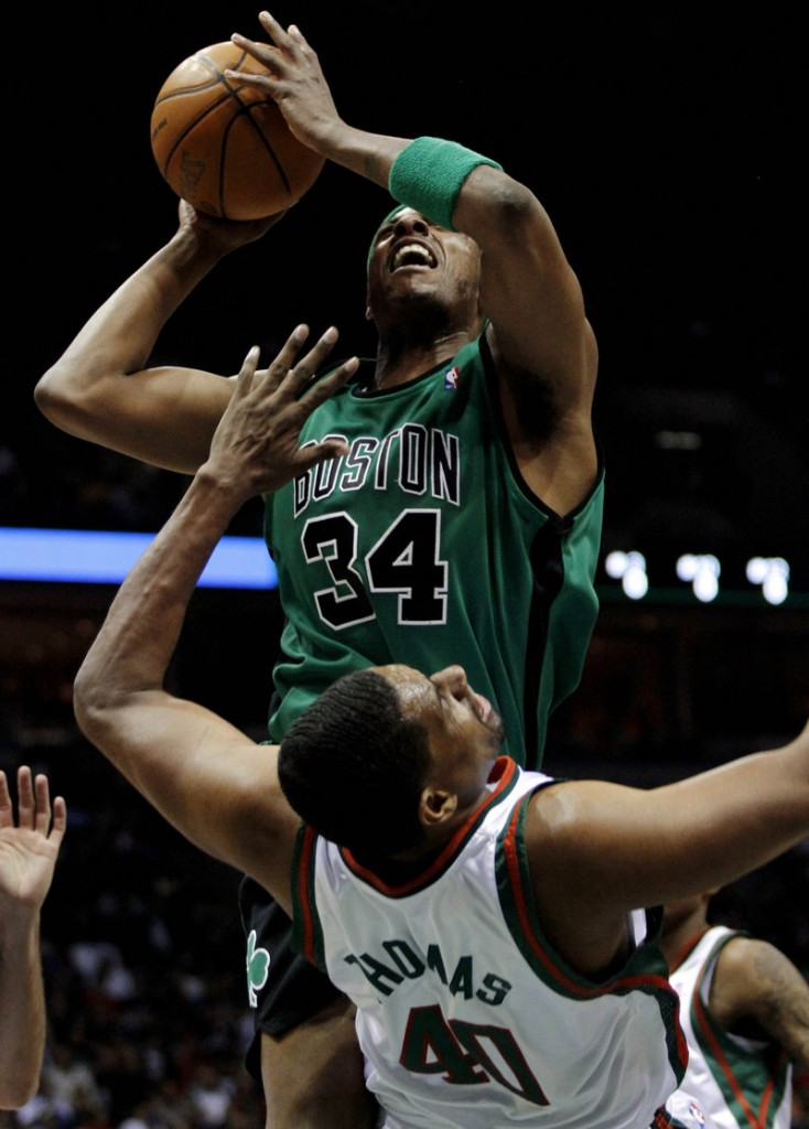 Paul Pierce of the Boston Celtics is charged with an offensive foul Saturday night as Kurt Thomas of the Milwaukee Bucks absorbs the hit in the Celtics' 105-90 victory.