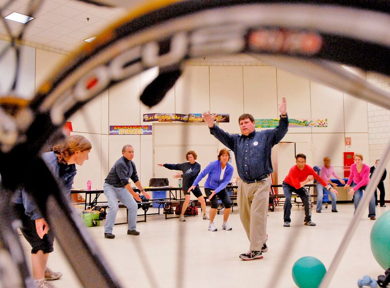 Tim Drown of To Be a Champion leads training for swimmers as part of a triathlete clinic at the Riverton Community Center Pool in Portland on Sunday. The aspiring triathlon competitors could also take part in a running seminar and a bike-fit clinic.