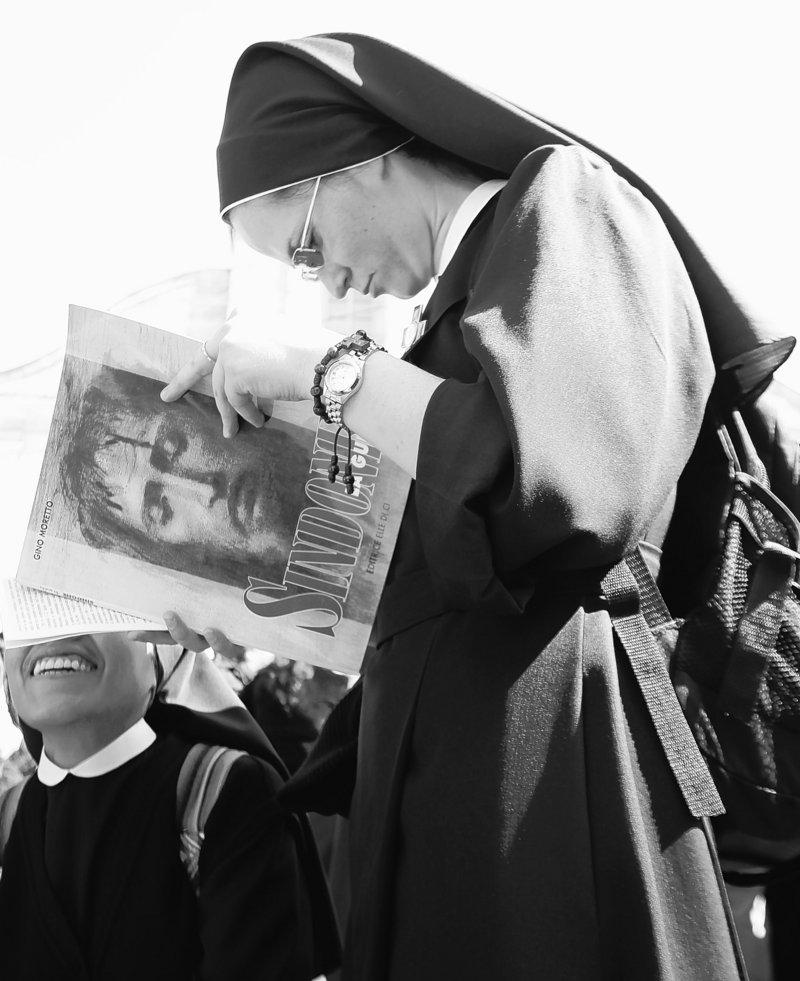 A nun reads a book about the Turin Shroud prior to a Mass on Saturday outside the cathedral in Turin, Italy, where the linen will be on display for the next six weeks starting next Saturday. The cloth is the object of centuries-old fascination.