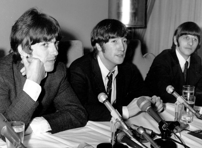 """On Aug. 11, 1966, in Chicago, Beatle John Lennon, flanked by bandmates George Harrison, left, and Ringo Starr, apologizes for saying that """"the Beatles are more popular than Jesus."""""""