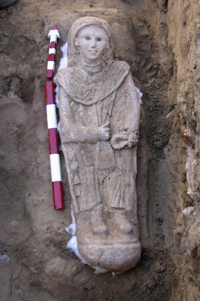 A carved plaster sarcophagus showing a woman dressed in a tunic was found at a desert oasis in Egypt. The burial style indicates the sarcophagus belonged to the period of Roman rule, from 31 B.C. until the Arab invasions of the 7th century.