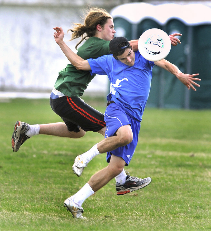 Merriconeag's Jacob Kolda, left, breaks up a pass to Falmouth's Will Wegner at the Cumberland Fairgrounds. Deering, Freeport and Greely also compete in the high school club league.