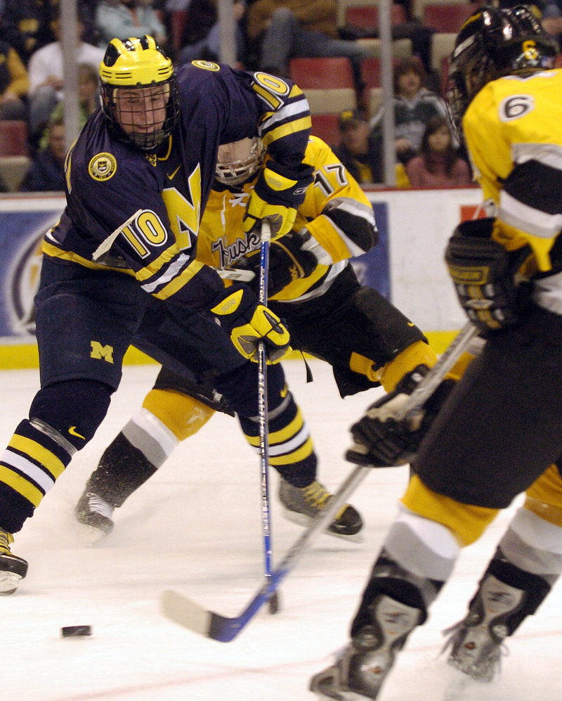 Travis Turnbull played for the Portland Pirates while he still had four courses remaining toward a defree at Michigan.