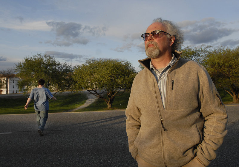 "Jay York of Portland, who routinely uses his iPhone camera to document the hazards of jaywalking, stands along Franklin Arterial on Monday. ""It is so blatantly obvious how dangerous these crossings are,"" he said."