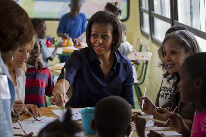 Michelle Obama paints Tuesday at a center for displaced children in Port-au-Prince. The visit was intended to underscore the U.S. commitment to reconstruction after the January earthquake.